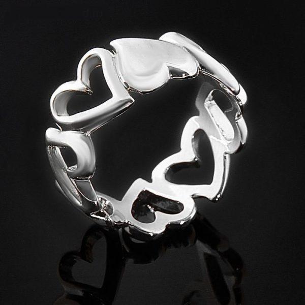 Кольцо переплетенные сердечки